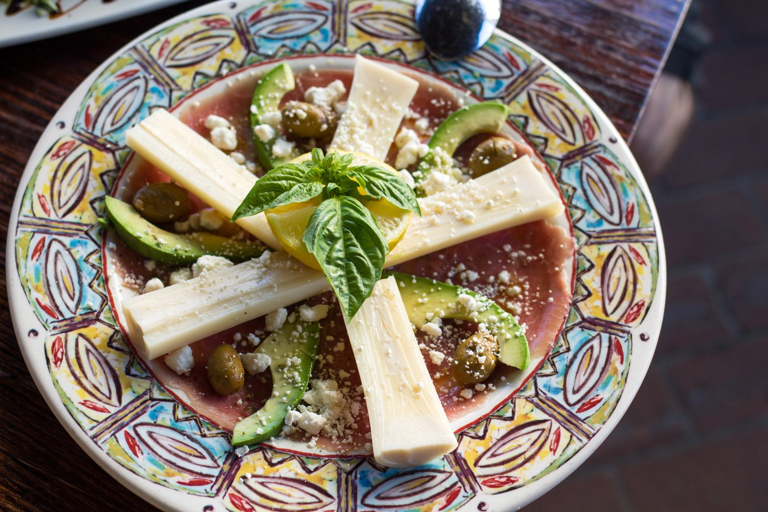 The Carpaccio Palmito - Thinly slice filet mignon with hearts of palm and avocado.
