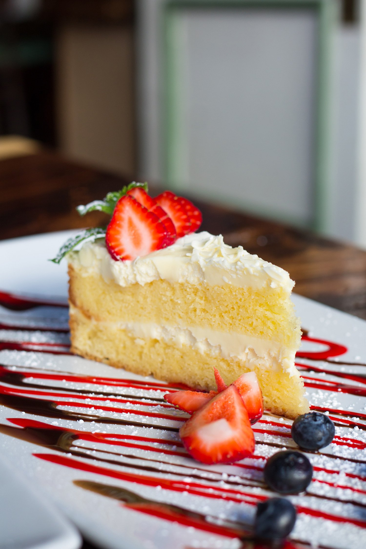 Limoncello Cake with strawberries on top.