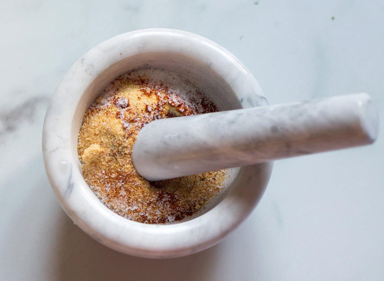 Sweet & Spicy Seasoning In A Mortar & Pestel
