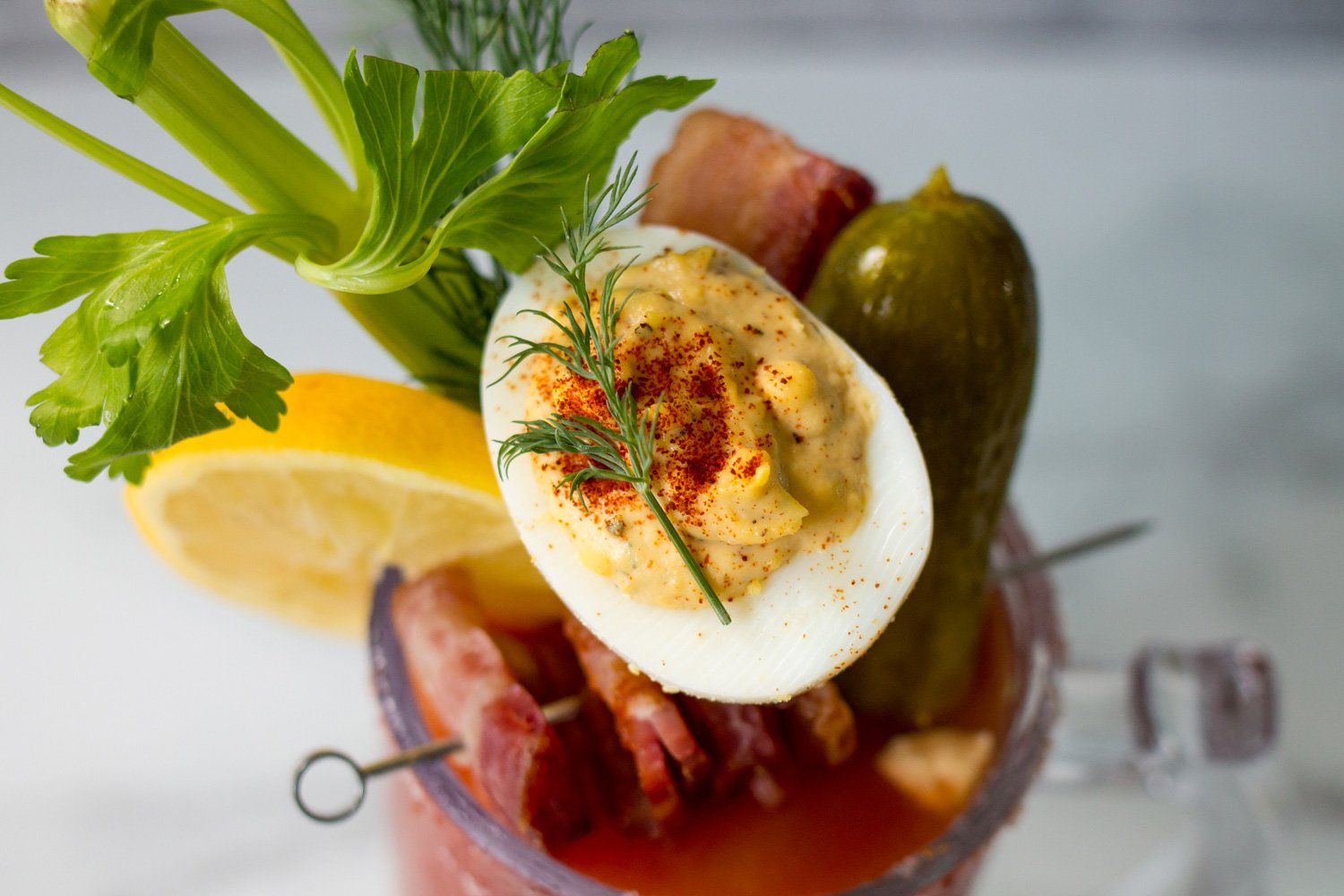 A close up shot of a deviled egg on top of the Briney Mary