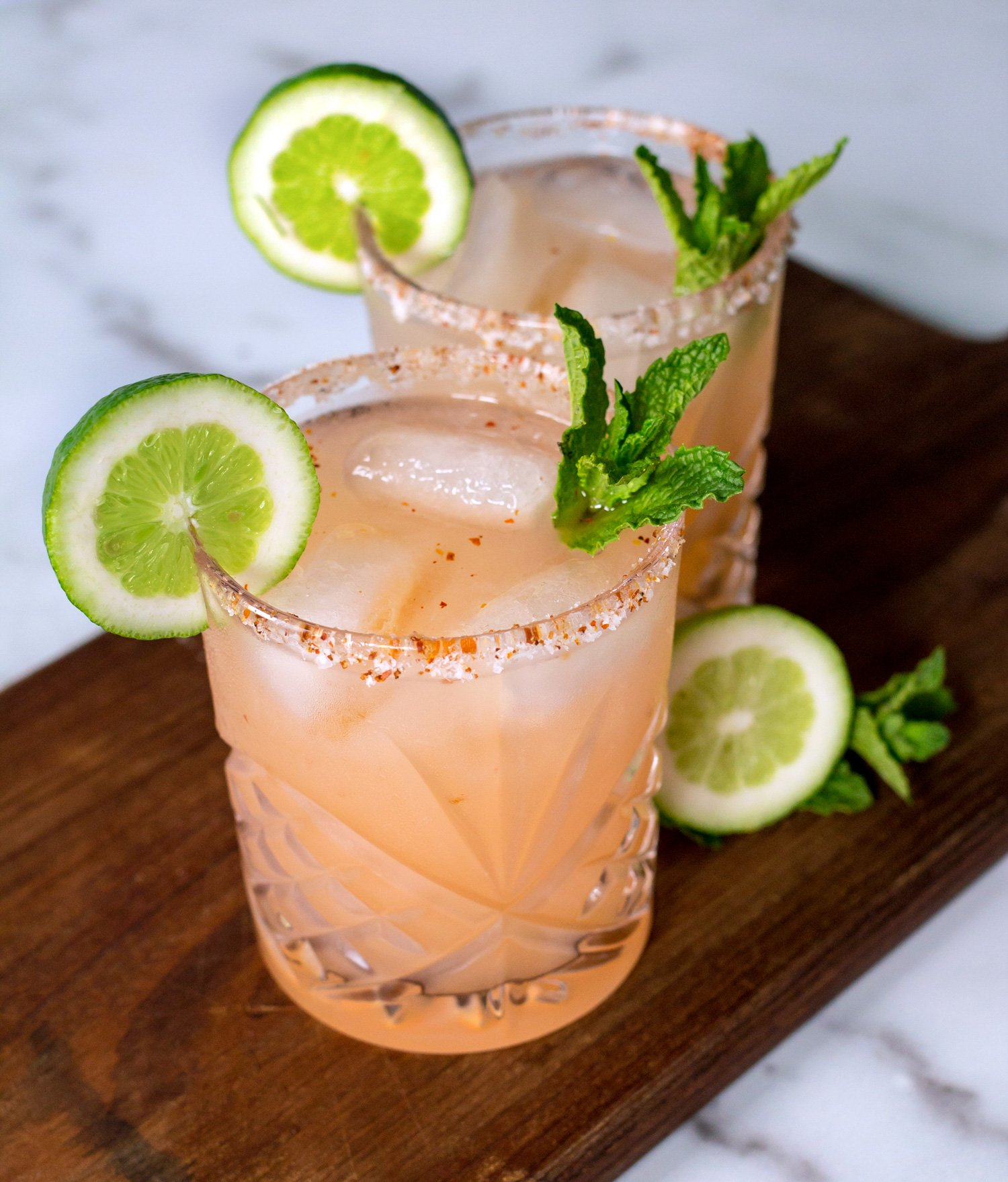 Two Paloma Cocktails With Lime Wheels & Mint