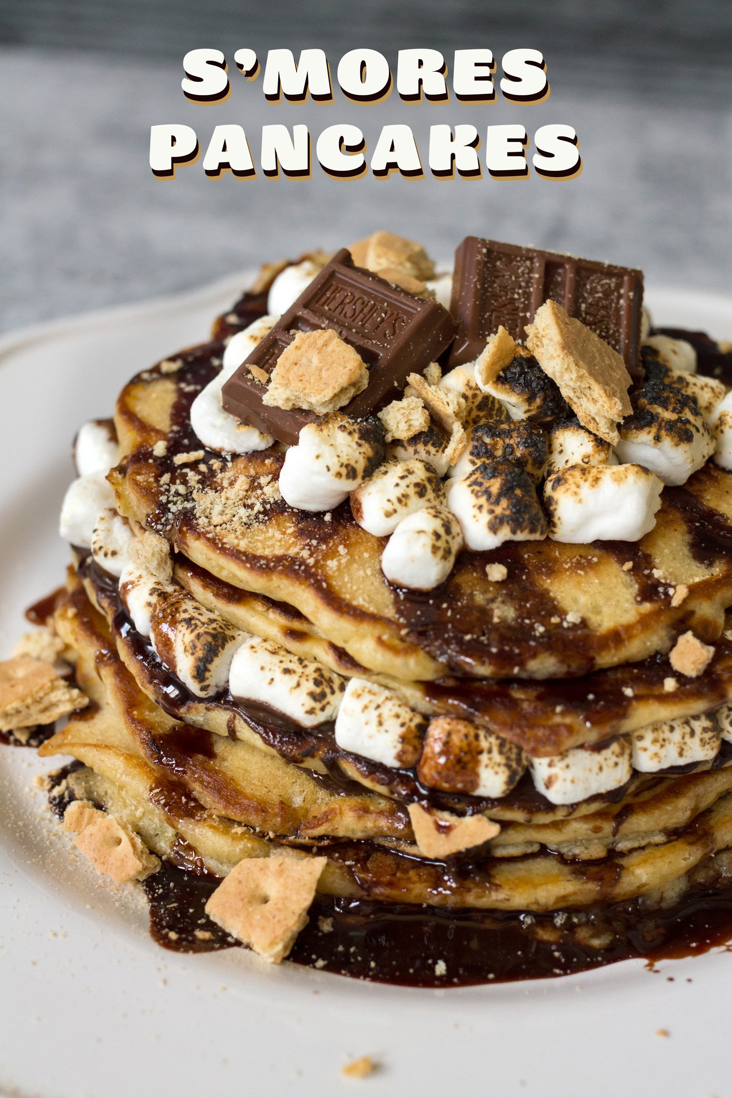 S'mores Pancakes That Are Topped With Graham Cracker Crumbs And Toasted Marshmallows