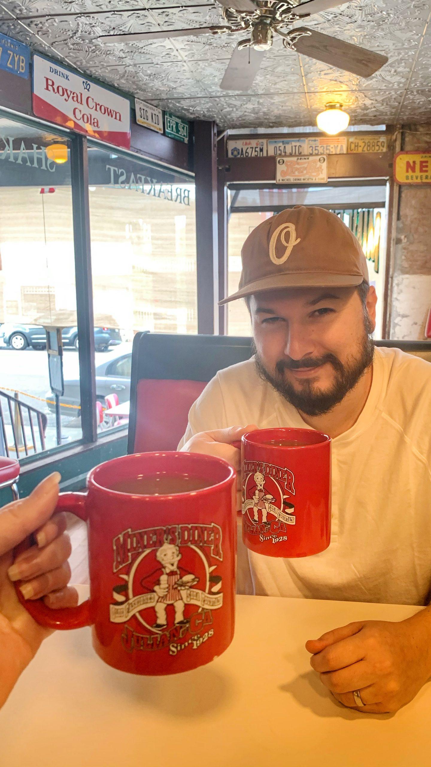 Jarod at Miner's DIner with a mug of cider