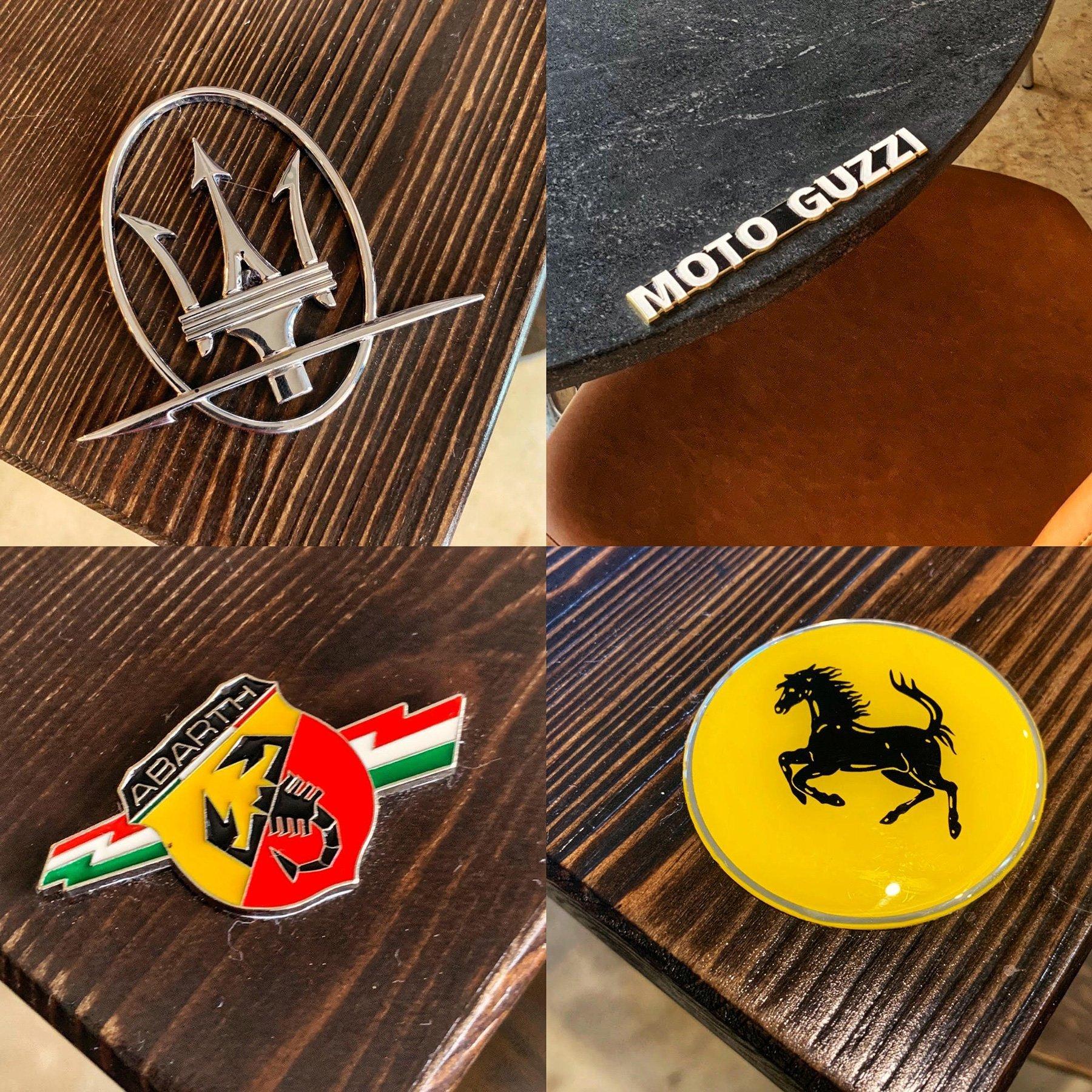 Italian Racing Car Emblems On The Restaurant Tables