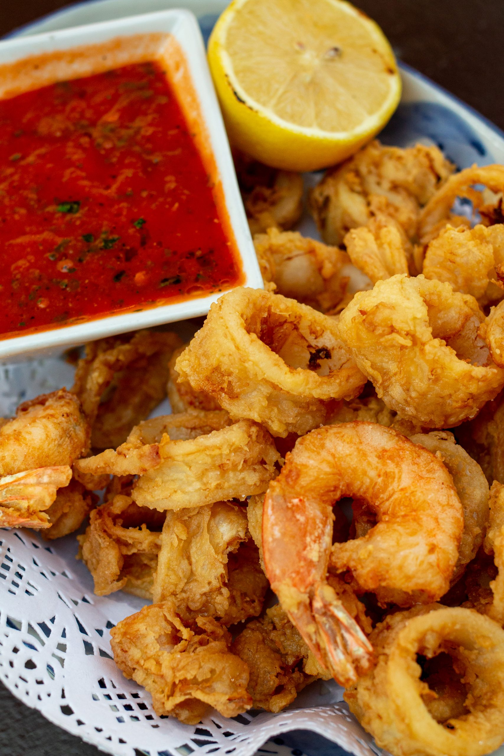 Crispy calamari and shrimp with a side of marinara.